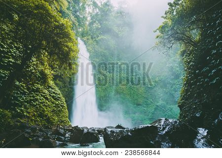Great Waterfall With Powerful Flow In Bali. Tropical Forest And Waterfall