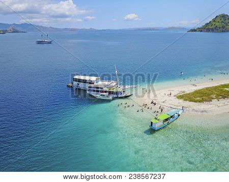 Beautiful Aerial View Of Beaches And Tourist Boat Sailing In Flores Island, Indonesia.