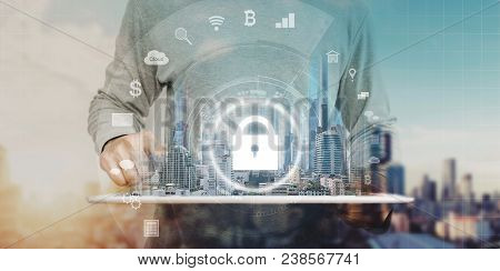 Cyber Internet Security System. Businessman Using Digital Tablet And Security Lock Technology Icons