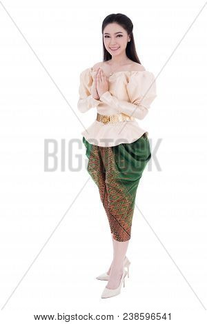 Woman In Thai Traditional Dress Is Pay Respect Isolated On White Background
