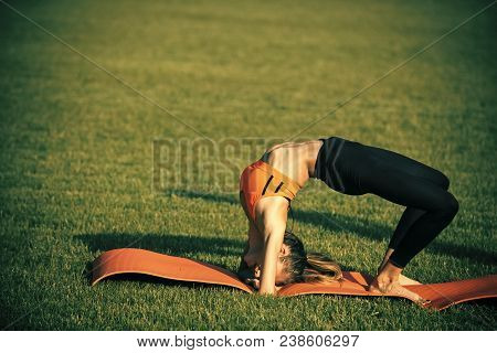 Woman Sportswoman Training On Green Grass, Sport. Sexy Woman Athlete Do Yoga Exercises, Activity. Sp