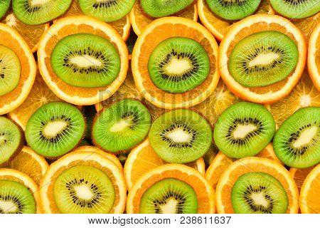 Fruity background set of slices of orange fruit and kiwi. Many slices of kiwi fruit and orange fruit, Fresh kiwis and orange fruit, interesting composition poster