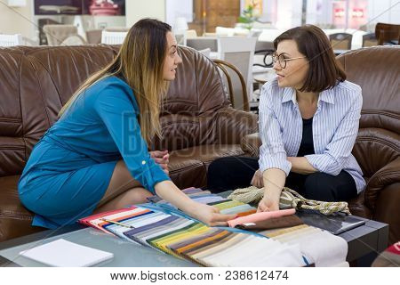 Interior Designer And Client-adult Woman Matching Color Samples Of Fabrics For Curtains, Home Textil