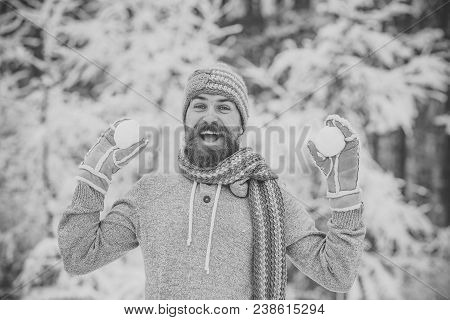 Hipster In Thermal Jacket, Hat, Scarf, Beard Warm In Winter. Bearded Man Smile With Snowballs In Sno