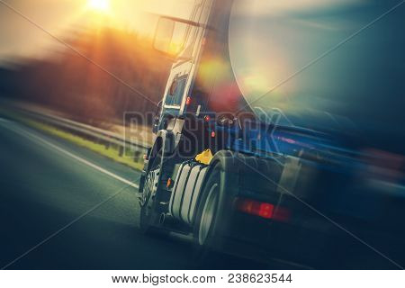 Fuel Tanker Truck On The Road. Modern Land Transportation Theme. Semi Truck Vehicle.