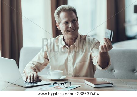Adult Confident Man Pays For Lunch At Restaurant. Concept Of Consumerism.