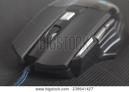 Computer Modern Gaming Mouse On Black Mouse Pad Close Up