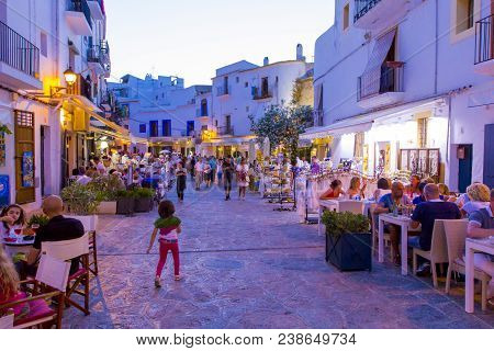 Ibiza, Bolorear Islands, Spain - June 11, 2014: Street In Old Town With Strolling Promenade Tourists