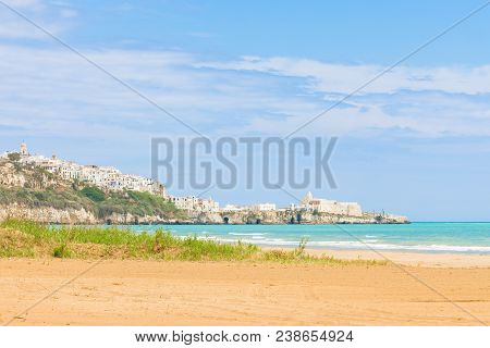 Vieste, Italy, Europe - Looking Towards The City Ledge From The Beach Of Vieste