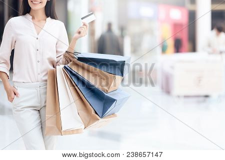 Happy Brunette With Shopping Bags At Mall. Sale. Shopping Concept. Consumerism Concept.