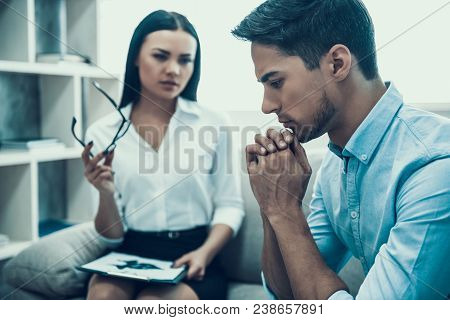 Young Upset Man At Psychologist Reception. Consulting Psychologist Reception.