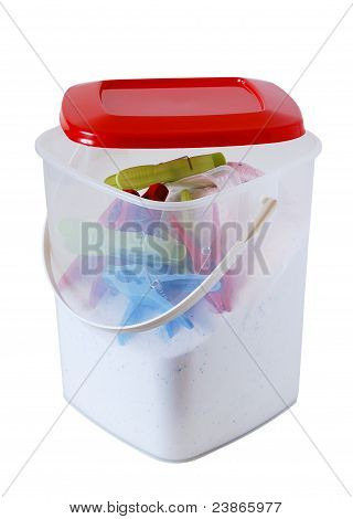 White Plastic Bucket With Soap Powder And Clothespins