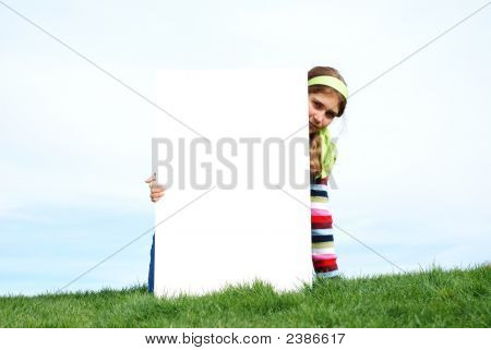 Young Girl Holding Blank Sign
