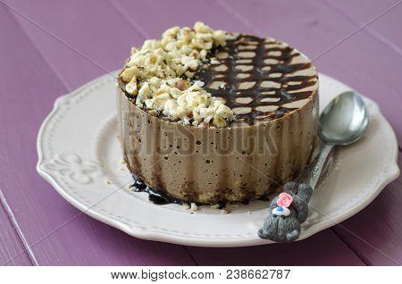 Cheesecake With Carob Nuts Chocolate Sauce And Agar