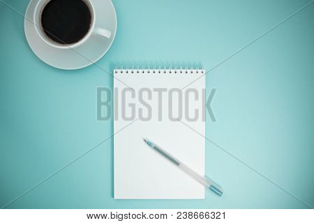 Creative Flat Lay Photo Of Workspace Desk With Paper Notebook, Pen And Coffee With Copy Space Color