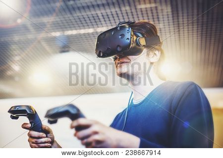 Young Man Use Virtual Reality  Goggles Or Vr Headset Or Helmet, Play Videogame With Wireless Control