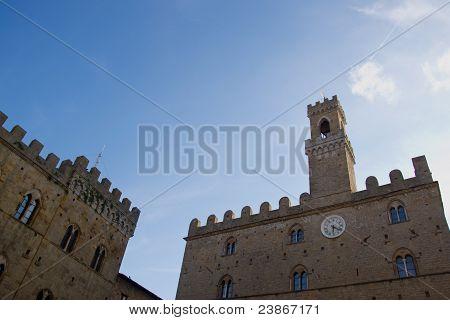 Volterra in Tuscany, looking up view from Piazza dei Priori (Priori Square), to Palazzo Vescovile and Palazzo dei Priori poster