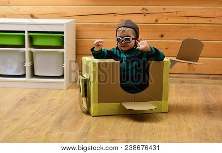 Little Boy Child Play In Cardboard Plane, Childhood. Pilot Travel, Airdrome, Imagination. Air Mail D
