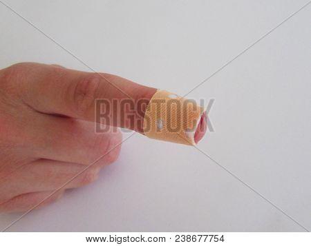 Bandage On Fingertip. Cut Finger Band. Finger Bandage. Bandage On An Injured Finger.