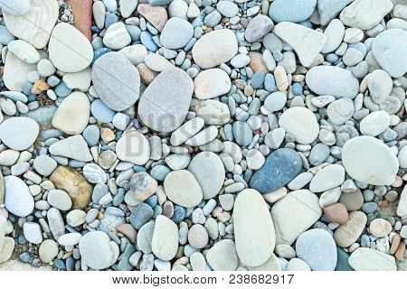Large Grey Pebble Occupies The Entire Space Of The Frame, Colorfull