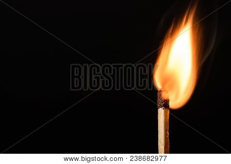 Match With Strongly Flaring Flame On A Black Background Closeup