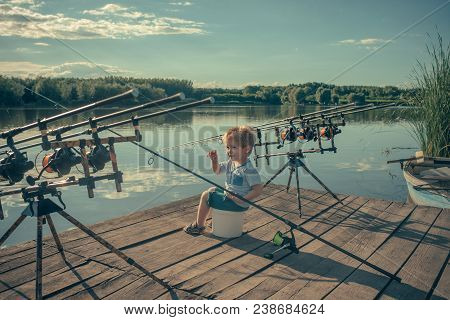 Angling, Fishing, Activity, Adventure, Hobby, Sport. Angling Child With Fishing Rod On Wooden Pier.