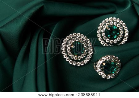 Emerald Ring And Pair Of Diamond Earrings In Gold, Wedding Jewelry With Luxury Gift Box , Close-up.