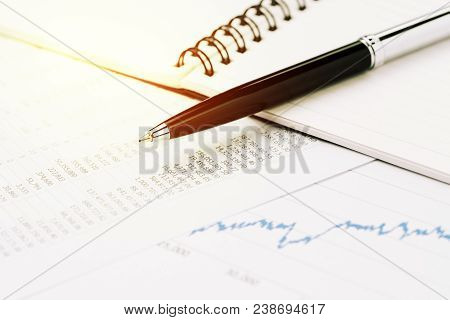 Financial market price list, stock, bond or equity analysis for investment concept, pen on note book with graph and chart, price numbers table report print paper on table. poster