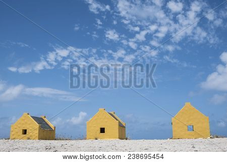 Small Yellow Slave Huts Of Bonaire Caribbean