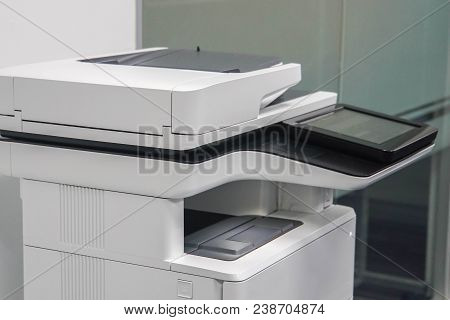 close up multifunctional printer in office for use in printing and scanning business documents in black and color poster