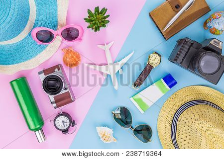 Outfit And Accessories Of Traveler On Blue And Pink Background With Copy Space, Travel Concept.overh
