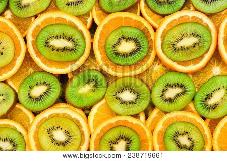 Fruity Background Set Of Slices Of Orange Fruit And Kiwi. Many Slices Of Kiwi Fruit And Orange Fruit