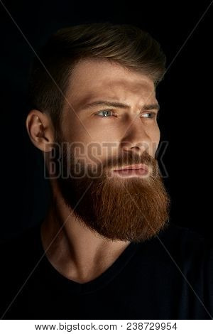 Closeup Of A Man With Beard And Mustache Over Black Background. Perfect Beard