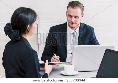 Businesswoman Showing To The New Contract For Businessman Signing Contract Document At Office