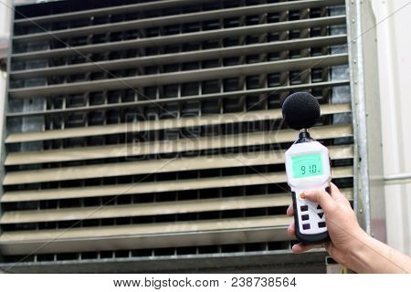 Sound Level Meter Measuring The Noise Of Industrial Ventilation Unit.