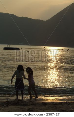 Sunset Beach Silhouette Of Boy And Girl