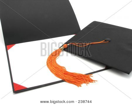 Graduation Cap, Tassel, And Empty Diploma Frame