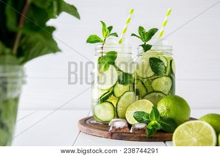 Fruit And Herb Infused Water With Cucumber, Lime And Mint On White Background. The Concept Of Detox