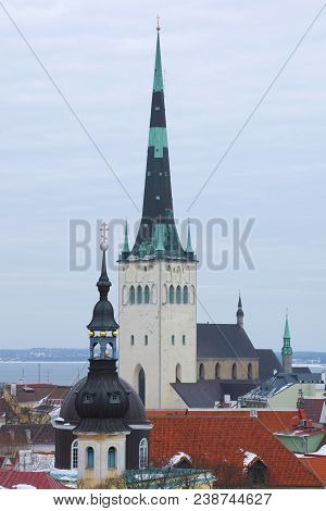 The Spire Of The Church Of Oleviste (st. Olaf) Close Up On A Cloudy March Day. Tallinn