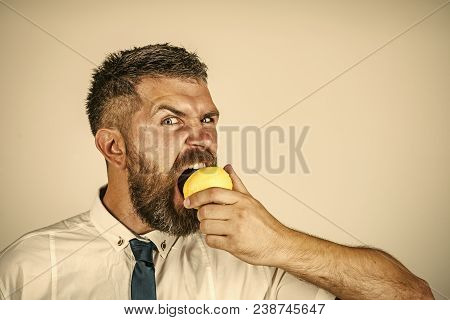 Man With Long Beard Eat Lemon. Vitamin Citrus At Hipster On White Background. Vegetarian, Health And