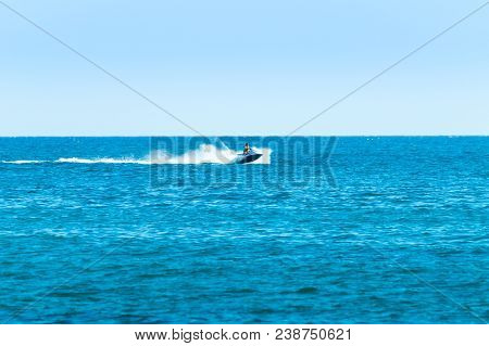 Albufeira, Portugal - September 09, 2016: Person Riding A Jet Boat Jet Ski By The Coasts Of Albufeir