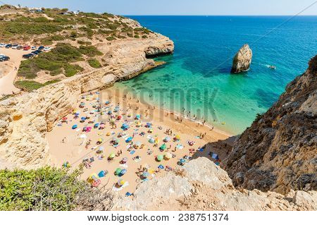 Lagoa, Portugal - August 31, 2017: People Enjoying Their Time Under Colorful Umbrellas On Carvalho B