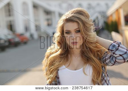 A Young Beautiful Woman With Long, Wavy Hair And Green Eyes, Beautiful Makeup, Pink Plump Lips, Swee