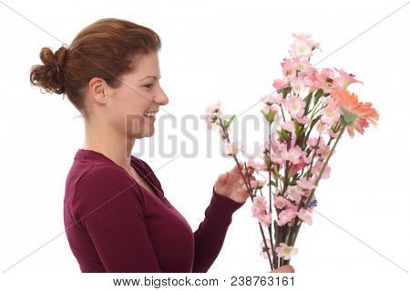 Portrait of happy young woman with flowers, isolated on white background.