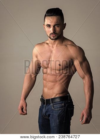 Man With Muscular Body And Torso. Coach Sportsman With Bare Chest In Jeans. Athletic Bodybuilder Man