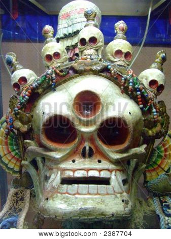 poster of Mongolian Ongghot mask in the 'Ulaanbaatar Monastery Museum Of Choijin Lama' in Mongolia used to scare away evil spirits.