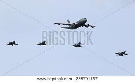 Berlin - Apr 27, 2018: German Air Force Airbus A310 Mrtt Plane Aerial Refuelling Two Eurofighter Typ