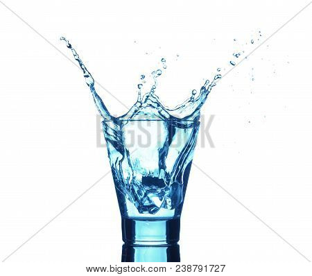 Water Splash In Glasses Isolated.