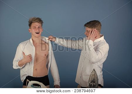 Men Getting Dressed. Happy Brother Wearing Shirt Wrong And Giving Thumbs Up Hand Gesture. Twin Looki