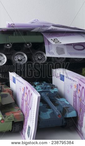 Close Up Green And Blue Tank Toy 3 Pcs. Placed On Euro Banknotes Pile. Business And Economy War. New